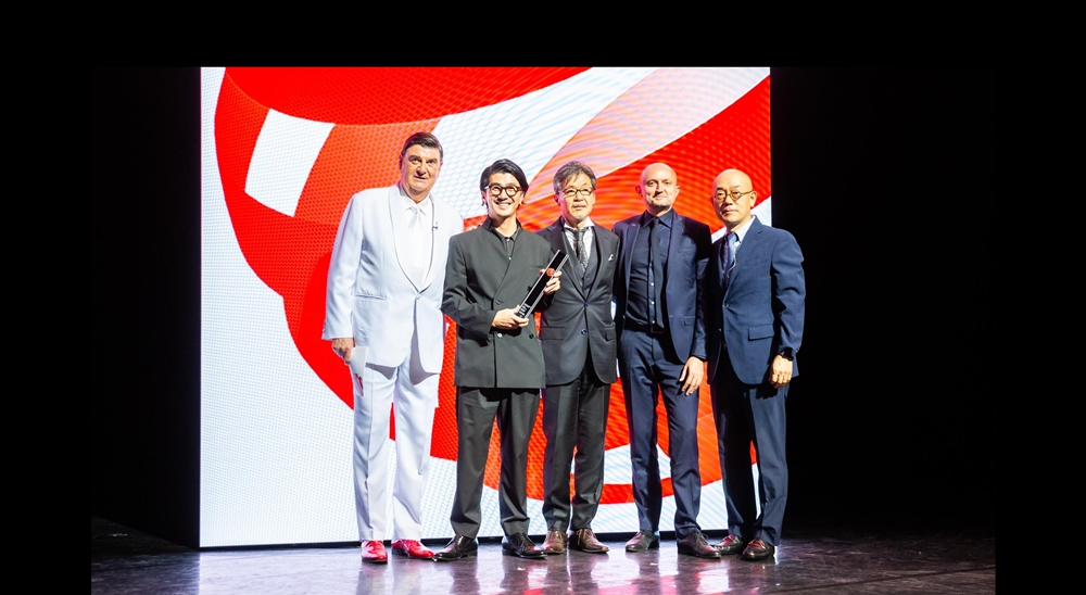 Persons on the image (from left to right) are Prof. Dr. Peter Zec (managing director Red Dot Group) Yasutake Tsuchida (Chief Designer of the All-New Mazda3), Ikuo Maeda (Head of Design), Jo Stenuit (European Design Director), and Prof. Dr. Ken Nah